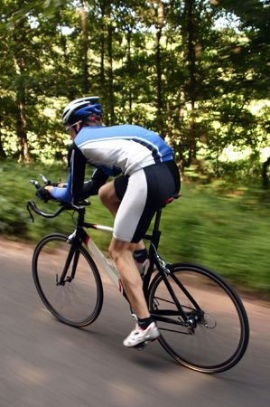 road bike: An action shot of a cyclist on a road bike during a race.