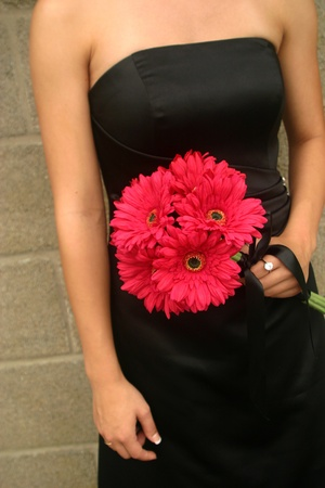 A chic image of a bridesmaid with her bouquet photo