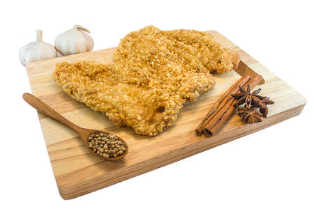 Taiwanese fried chicken on Chopping Wood with white background.