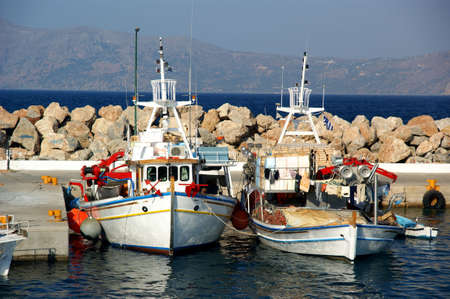 Fishing boats in a Mediterranean port. photo