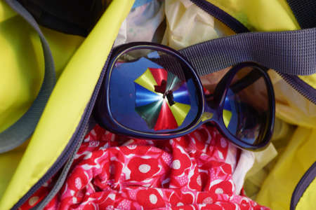Reflex in the lens of the glasses with bags and cloth - Colors Compositiion Stock Photo