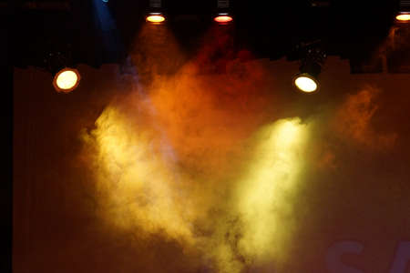 Colored lights illuminate the theatrical stage Stock Photo