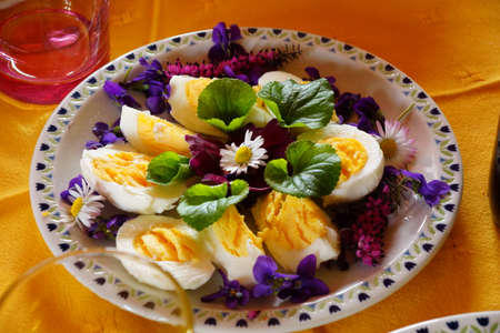 Easter lunch with eggs, salad and violets