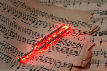tune: Old classic guitar notes with burn effect Stock Photo