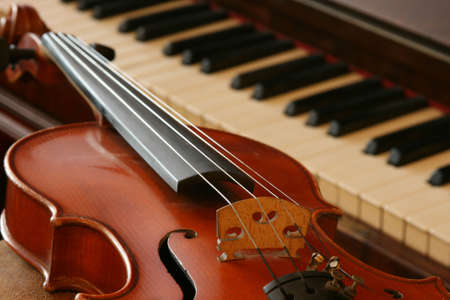 violins: Old violin and an old walnut piano Stock Photo