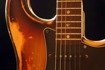 strat: 1970s sunburst strat with dust and scratches on Stock Photo
