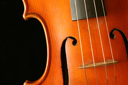 1920s handmade violin detail isolated on black photo