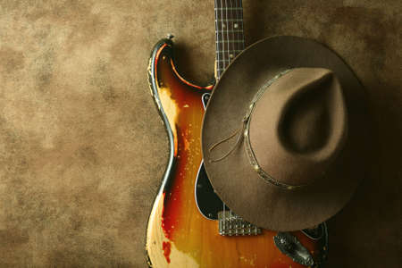 vintage music background: 1970s strat and a cowboy hat, isolated