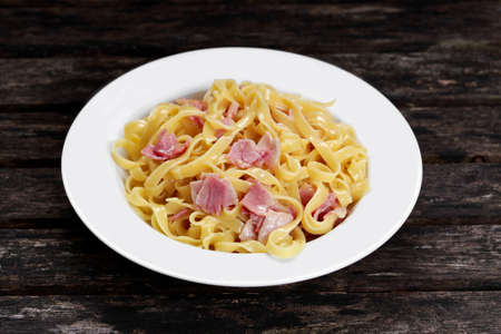 gastro: Pasta carbonara with tagliatelle spaghetti with bacon, egg york and Parmesan Cheese