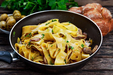 Pappardelle Pasta with mushrooms and other herbs. 스톡 콘텐츠