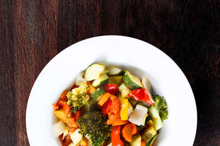 brocoli: Cooked Roasted Vegetables stewed Tomatoes, Carrots, Peppers, Courgettes, brocoli, onion on plates