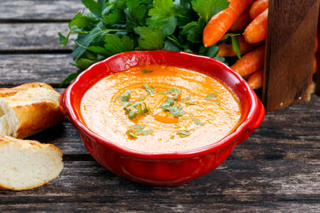 slurp: Carrot cream soup with vegetables and bread. Stock Photo