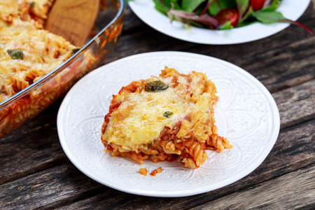 tunny: Tuna Pasta Bake with cheese and tomatoes. Stock Photo