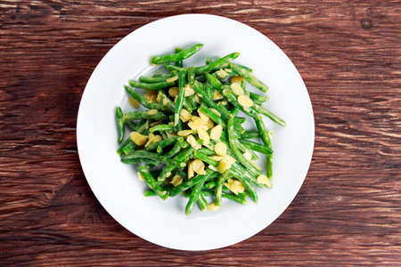 greenbeans: Green beans roasts garlic and flaked almond. Stock Photo