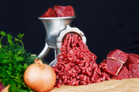 minced beef: Mincer with fresh minced beef meat with vegetable Stock Photo