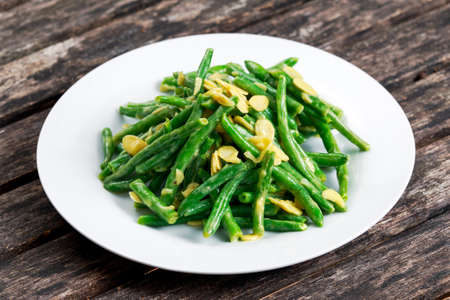 greenbeans: Green beans roasted in garlic and flaked almond. Stock Photo