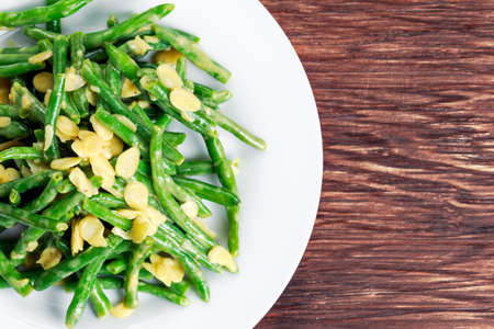 flaked: Green beans roasted in garlic and flaked almond. Stock Photo