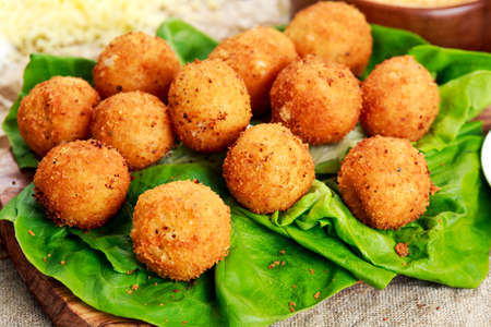 Fried mozzarella cheese stick balls and ingredients.