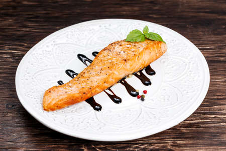 balsamic: Fried salmon fillet served with reduced balsamic vinegar.