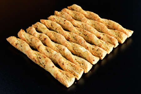 pretzel stick: Curly bread sticks with onion and chives.