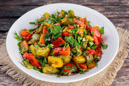 Grilled paprika salad with fresh parsley and basil.