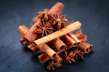 anice: Cinnamon sticks and anice on wooden table. selected focus. Stock Photo