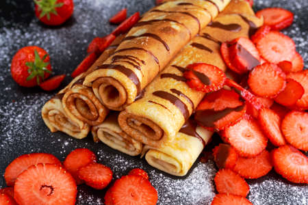 nutella: Sweet Rolled Pancakes with nutella and strawberry. Stock Photo