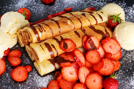 nutella: Sweet Rolled Pancakes with nutella, strawberry and ice cream.
