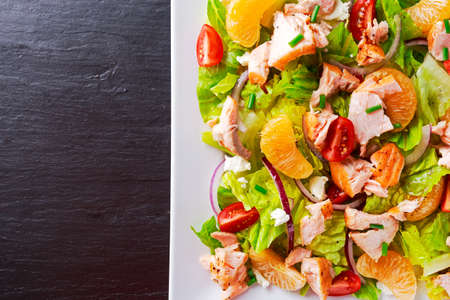 Fresh Orange vegetables Salmon salad. healthy food concept 스톡 콘텐츠