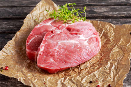 Fresh Raw Pork Shoulder on scrumbled paper. Banco de Imagens - 60415172