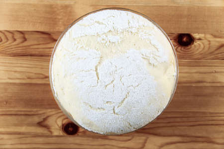 freshly prepared: Freshly prepared dough on a wooden board