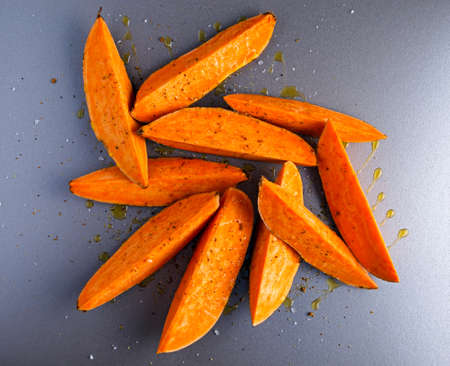Freshly ready tp cook sweet organic potato fries Stock Photo