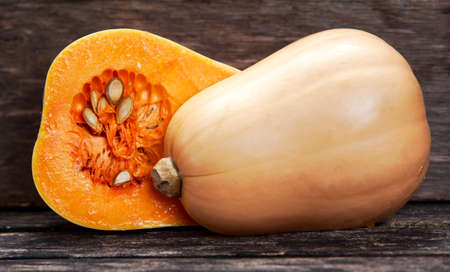 Fresh butternut squash slice on wooden table. Stock Photo