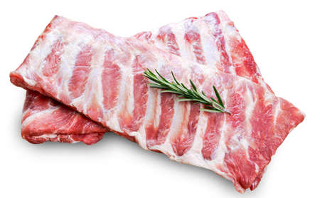 Raw  Pork ribs with a rosemary isolated on white.