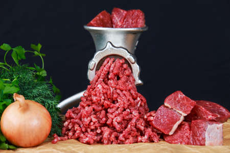 Mincer with fresh minced meat.