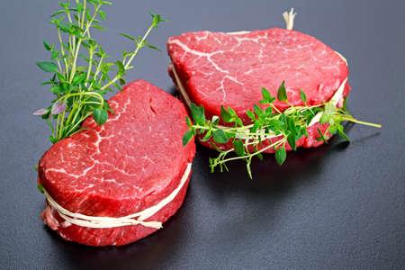 Fresh Raw Beef steak Mignon with thyme