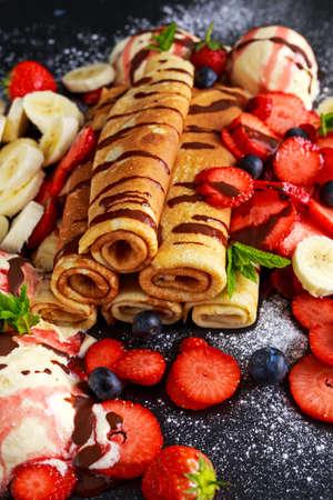 nutella: Sweet Rolled Pancakes with nutella, strawberry, blueberry, banana ice cream Stock Photo