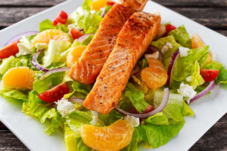 Fresh Orange Salmon salad with honey, tomatoes, onion, mandarin. healthy food concept