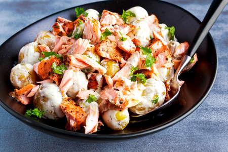lemony: Salmon and young potato warm salad with a lemony yogurt dressing. Stock Photo