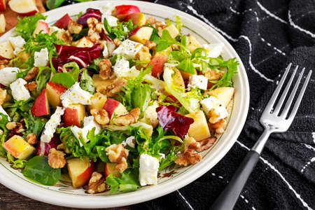 flavorful: Light Fresh Home made fruit apple salad with walnuts, vegetables, feta cheese.