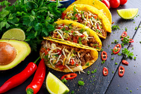 plates of food: Mexican food - delicious taco shells with ground beef and home made salsa. Stock Photo