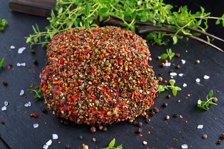 peppered: Raw peppered ground beef meat cutlets for burgers.