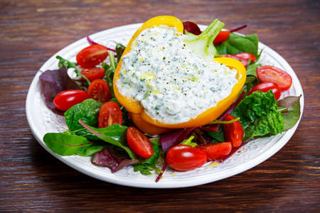 Peppers stuffed with cottage cheese, parsley, garlic