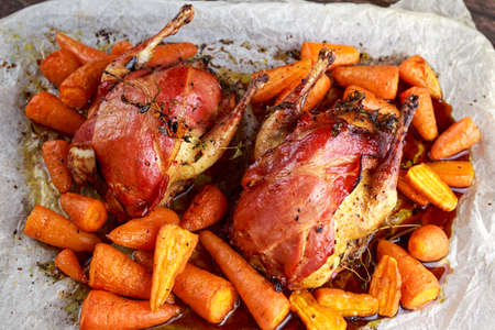 Ready to eat Roast partridges with bacon on crumpled paper Stock Photo