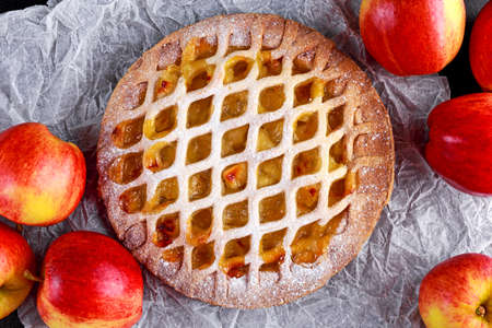 home baked: Home baked Lattice apple pie on crumpled paper.