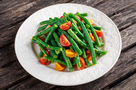 greenbeans: Green beans salad with Red, Yellow Tomatoes on white plate