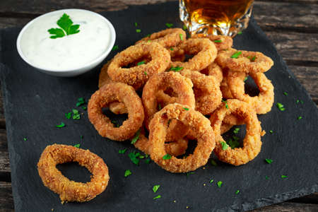 Fried Breaded Onion Rings with sauce and beer Stock Photo