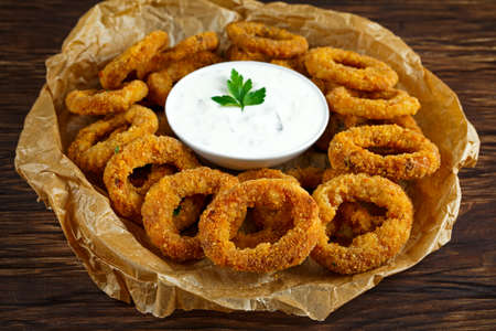 Fried Breaded Onion Rings with sauce on baked pepper