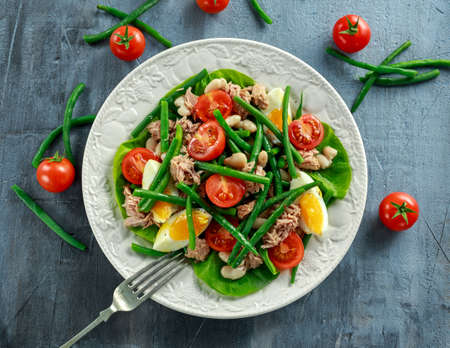 Fresh Tuna Green Bean salad with eggs, tomatoes, beans on white plate. concept healthy food
