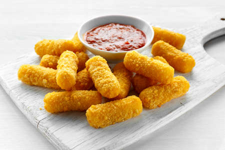 Breaded mozzarella cheese sticks with tomato basil sauce Stock Photo